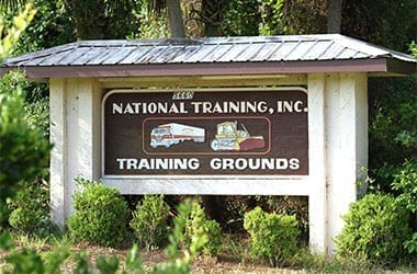 Sign at Entrance to the 350-Acre Training Grounds of National Training, Inc.